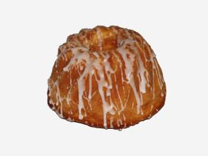Puszyste ciasto biszkoptowo – tłuszczowe o wilgotnym miękiszu i cytrynowym aromacie, udekorowane lukrem.