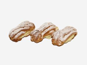 Krem budyniowy pomiędzy korpusami z ciasta parzonego. Całość udekorowana cukrem pudrem.