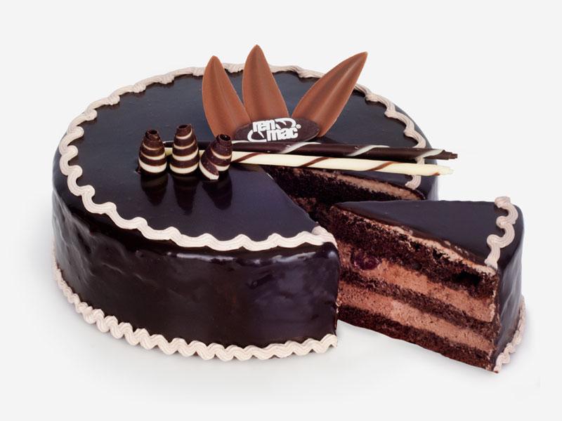 Połączenie ciemnego biszkoptu nasączonego alkoholem, kremu* oraz soczystych wiśni, które wzbogacają jego smak. Całość oblana polewą czekoladową. (* W swojej ofercie posiadamy również wersję tortu węgierskiego na śmietanie).
