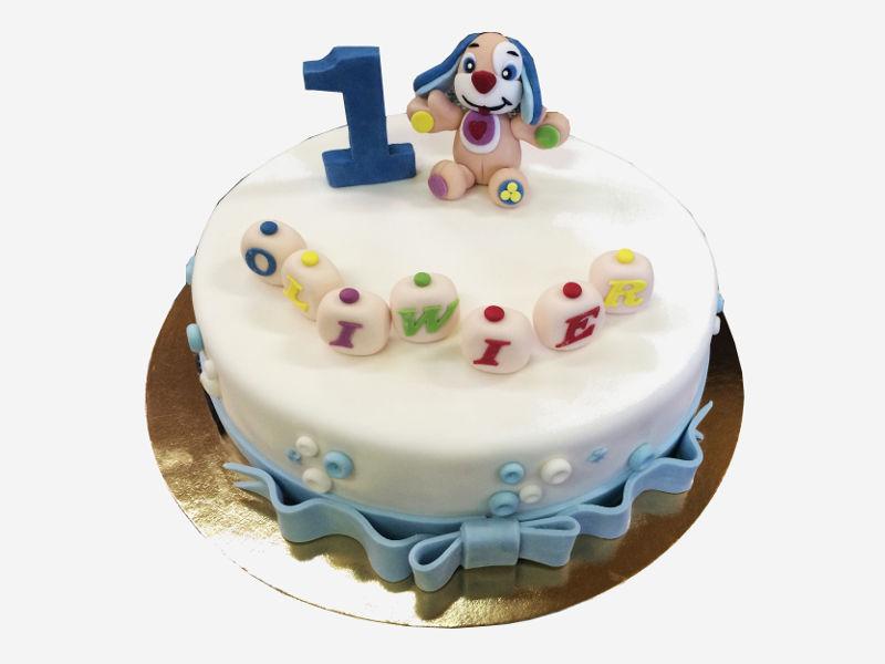 Tort przygotowany na roczek z uwielbianą przez dzieci postacią pieska Uczniaczka.